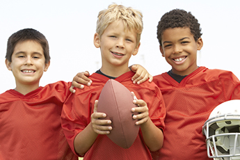 kids holding football